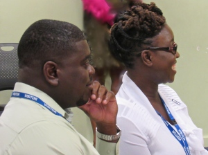 Lavare Henry and Sherika Whitelocke-Ballingsingh enjoy a joke at the pre-departure briefing. (My photo)