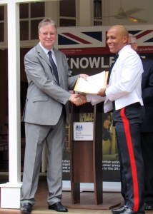 Assistant Superintendent of Police Gordon Ellison receives his certificate from High Commissioner David Fitton. (My photo)
