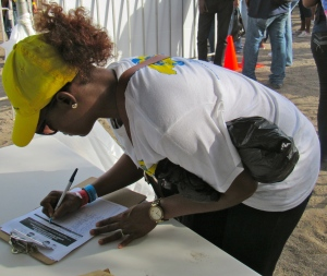 The National Solid Waste Management Agency's team leader signs up.