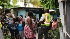 Residents of Mud Town, an informal settlement in St. Andrew, are upset at the death of barber Kevin Sylvester during an alleged shootout with the police. (Photo: Loop Jamaica)