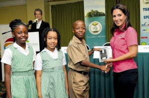 Suzanne Stanley presents a prize to students of West Indies College Prep in her previous capacity as JET's programme director. (Photo: JET/Jamaica Observer)