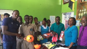 Usain Bolt donates his branded sports gear to William Knibb Memorial High School, his alma mater. (Photo: iamajamaican.net)