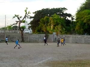 "Boys playing football in Vin Lawrence Park, First Street, Trench Town. The ""park"" needs to be much greener. (My photo)"