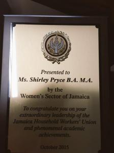 A plaque presented by Jamaican women's groups in recognition of Shirley Pryce's work for Jamaican domestic workers. (Photo: Jean Lowrie-Chin/Twitter)