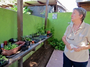 Principal Hilary Sherlock with seedlings that will be sold to support the school. (My photo)