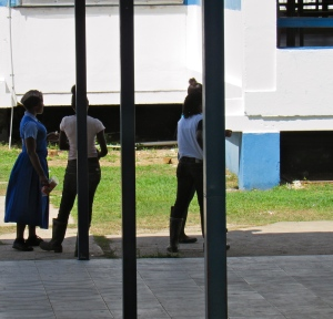 Jose Marti Technical High School was built by the Cubans in the 1970s and intended as a school for the agricultural and industrial sciences. A group of girls in wellington boots arrived to wash their hands at the communal sink. (My photo)