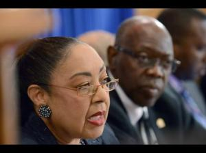 Dr. Marion Bullock Ducasse, Chief Medical Officer at the Ministry of Health, speaks at a press briefing. Minister Fenton Ferguson is in the background. (Gleaner file photo)