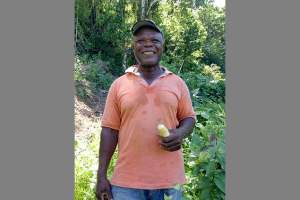 Many older Jamaicans in rural areas engage in agriculture. This is Paul Forgie, who received assistance for his farm after Hurricane Ivan in 2004. (Photo: Carol Han, USAID/OFDA)