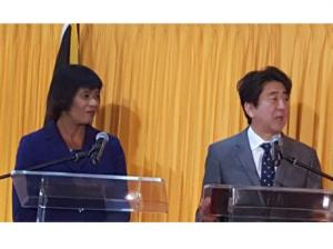 Prime Minister Portia Simpson Miller and Prime Minister Shinzo Abe of Japan address the media after bilateral talks. (Photo: Norman Grindley/Gleaner)