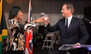 A toast! To the prison! Prime Minister Portia Simpson Miller and UK Prime Minister David Cameron during his visit. (Photo: Jamaica Information Service)