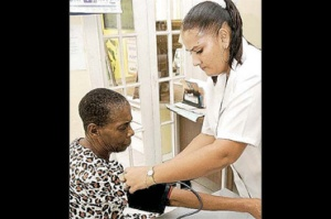 A patient at the WROC Clinic has her blood pressure taken.