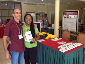 Conference Coordinator, the awesome Latoya West-Blackwood, poses with Nils Navarro - and his book,