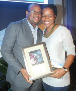 TVJ's Kayon Raynor and his wife Petre Williams-Raynor with Kayon's UNICEF award for children's rights reporting.