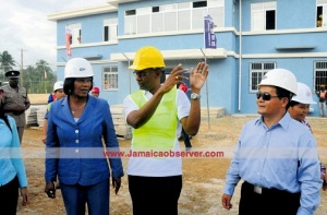 Prime Minister Portia Simpson Miller toured the second leg of the North-South Highway, to be opened in the first quarter of 2016. I'm sure she would love it to be completed before the elections! (Photo: Bryan Cummings/ Jamaica Observer)