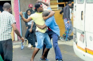Two men fighting on the street in downtown Kingston this week. Why can't we resolve our differences peacefully? (Photo: Bryan Cummings/Jamaica Observer)