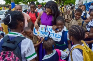 Youth Minister Lisa Hanna tries to get connected. (Photo: Jamaica Information Service)