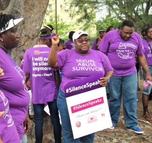 Joy Crawford of Eve for Life believes we should remain vigilant, speak up, be supportive, keep up the fight against violence against women. Jamaica AIDS Support for Life's Kandasi Levermore (left) listens. (My photo)