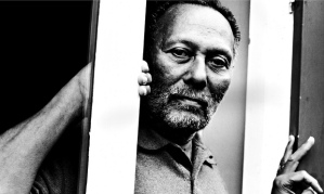 "Like Mais, Stuart Hall was born in Kingston to an aspiring middle class family. He arrived in the UK at the time of the ""Windrush"" migration wave from Jamaica in 1951 - on a Rhodes Scholarship to Oxford, and did not return. A teacher, cultural theorist and campaigner, he died in February 2014. (Photo: Eamonn McCabe)"