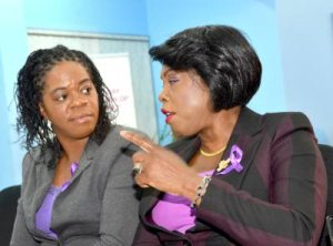 Lasco/Jamaica Constabulary Force 2015 Police Officer of the Year, Detective Sergeant Ava Lindo (left), is in conversation with Deputy Commissioner of Police Novlette Grant at a forum on gender-based violence, hosted by the Bureau of Women Affairs in partnership with the Management Institute for National Development (MIND), on December 4. (Photo: Jamaica Observer)