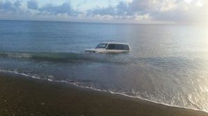 The car in the sea. (Photo: Irie FM)