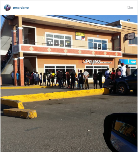 Sign of the times: An early morning line forms in May Pen, Clarendon outside the Western Union. Posted by a tweep.
