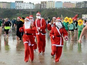Those crazy Welsh… A dip in the sea (a charity event) in Tenby today. Tweeted by Wales Online.
