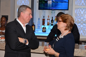 : Mr. Walter Bernyck, Counsellor and Head of Development Cooperation, High Commission of Canada and Ms. Galina Sotirova, Country Manager, Jamaica Country Office, World Bank exchange thoughts at the Hub and Spoke cocktail reception at the Courtyard at the Marriott.