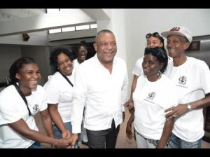 Health Minister Horace Dalley (centre) greets youth volunteers before the start of the Ministry of Health Youth Workers Sensitisation session: ZIKV Preparedness Enhanced Vector Control Programme at the Jamaica Conference Centre in downtown Kingston. (Photo: Rudolph Brown/Gleaner)