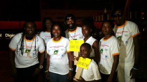 From left: Artistes Nazzle, Minori, Boom Dawn, Colah, Natacia Ryman, and Black Dice with young Kyla Scott and Collief Smith, who themselves participated in the mob, following the activity on November 20. (Photo: Panos Caribbean)