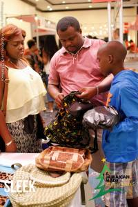 Customers examine samples of Randy McLaren's wonderful Bresheh backpacks. Jamaican schoolboys love 'em!