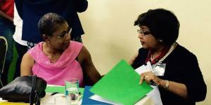 Jean Lowrie-Chin (right) was among 51% Coalition members who worked through many complex issues at the Tea and Talk event on December 15. (Photo: 51% Coalition)