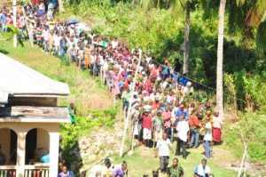 A Maroon procession makes its way from rituals at the Kindah Tree to the center of Accompong Town in St. Elizabeth on January 6. (Photo: Jamaica Observer)