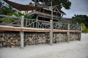 A property on Negril beach, now shored up at great expense due to the erosion. (Photo: Gleaner)