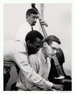 "Miles Davis, Bill Evans and Paul Chambers (playing bass) during the recording sessions for ""Kind of Blue."""
