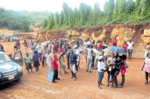 Communities affected by bauxite mining have been complaining over the conditions they endure for many years. This is a 2011 photograph of residents of Stepney, St. Ann, protesting damage to their farmlands and health conditions. (Photo: Alesia Edwards/Jamaica Observer)