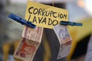 "A sign reads 'Corruption, laundering' during a protest in Buenos Aires, Argentina, on April 18, 2013. Transparency International's ""Global Corruption Barometer 2013"" report shows the impact of corruption on business around the world. (Daniel Garcia/AFP/Getty Images)"