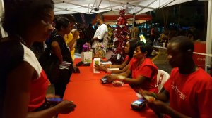 Customers at the Digicel booth at the downtown New Year festivities. (Photo: Twitter)