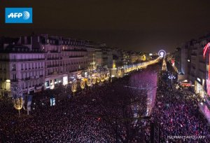 Crowds celebrate New Year in the Champs-Elysees, Paris. (Photo: Associated Press)