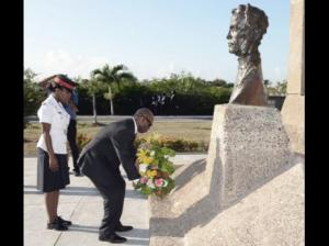 Steadman Fuller, custos of Kingston, lays a floral tribute in honour of The Right Excellent George William Gordon at the National Heroes Park on Wednesday. (Photo: Jermaine Barnaby/Gleaner)