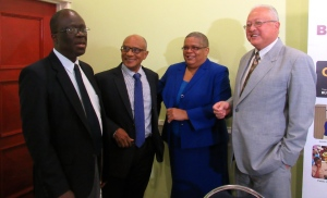 (l-r) Martin Henry, Chair and Professor Trevor Munroe, Executive Director of National Integrity Action, with Permanent Secretary in the Ministry of Justice Carol Palmer and Opposition Spokesman on Justice Delroy Chuck at the press briefing on the Corruption Perceptions Index 2015. (My photo)