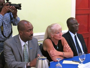 (l-r) Contractor General Dirk Harrison; Director of USAID Jamaica Dr. Denise Herbol; and NIA Chairman Martin Henry at today's press briefing. (My photo)