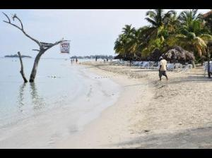 Negril beach is shrinking. (Photo: Jamaica Gleaner)