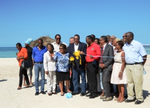 Tourism Minister Dr Wykeham McNeill (centre), cuts the ribbon to officially open the refurbished Burwood Beach in Falmouth, Trelawny. (Photo: JIS)