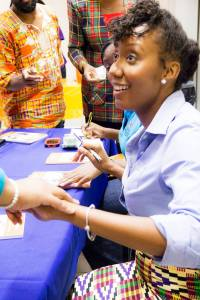 Dr. Onoura signs copies of her book at the launch. She was very happy that it sold out, and some of us went away empty-handed! (Photo: Facebook)