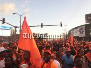 Happy orange partygoers. (Photo: Gleaner/Twitter)