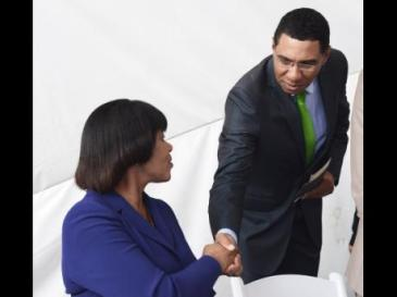 Prime Minister Portia Simpson Miller is greeted by Opposition Leader Andrew Holness during yesterday's signing of the Political Code of Conduct at Emancipation Park in New Kingston. (Photo: Gleaner)