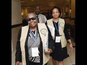 Janet Bostwick, head of the Observer Mission from the Organization of American States, leading a delegation from The Jamaica Pegasus hotel to observe the police, military and election-day workers voting on February 22. (Photo: Gleaner)