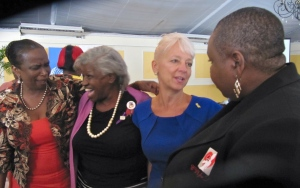 Eve's Executive Director Patricia Watson talks to the CEO of the Jamaica Public Service Company Kelly Tomblin at a breakfast for International Day for the Elimination of Violence Against Women. Ms. Watson and one of Eve's clients spoke on this occasion. (My photo)