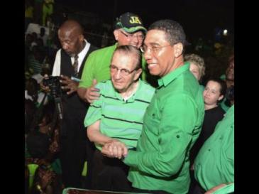 Prime Minister-designate Andrew Holness greets former Jamaica Labour Party (JLP) leader and Prime Minister Edward Seaga at the JLP headquarters on Belmont Road in St Andrew last night. (Photo: Rudolph Brown/Gleaner)