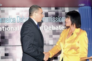 Opposition Leader Andrew Holness and Prime Minister Portia Simpson Miller shake hands at the 2011 televised political debate. No happy smiles and handshakes this time around. (Photo: Jamaica Observer)